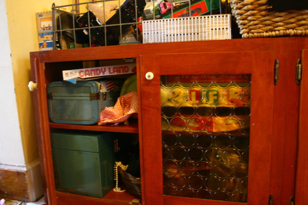Using an old kitchen cupboard o organize kids' stuff