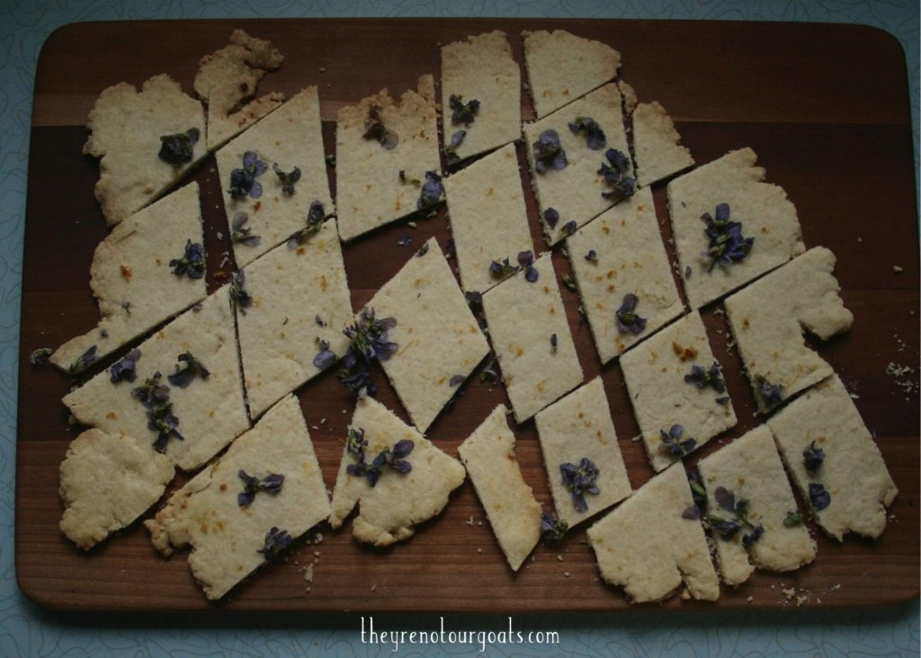 Lemon violet shorbread cookies, baked and cut into bite sized pieces.